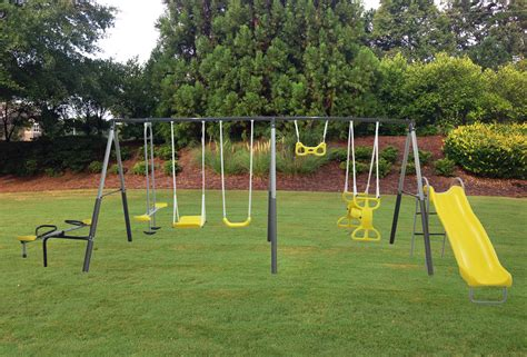 playground swing sets free photo playground swing set play playful plastic