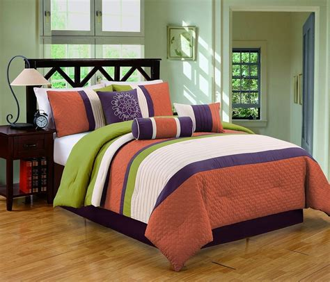 orange and green comforter decorating with a triadic color scheme in the bedroom