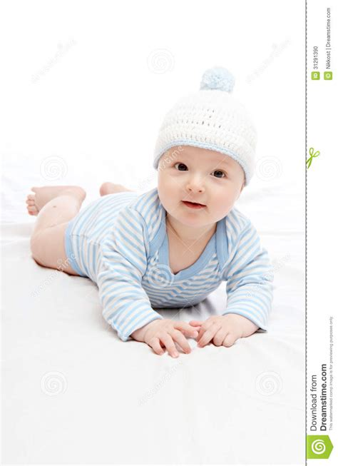 hat on the bed baby boy in hat stock photo image 31291390