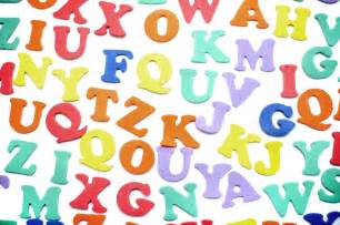 Random colourful consonants and vowels scattered on a white surface