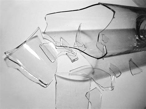 Glass Pieces free image of broken glass bottle pieces gray