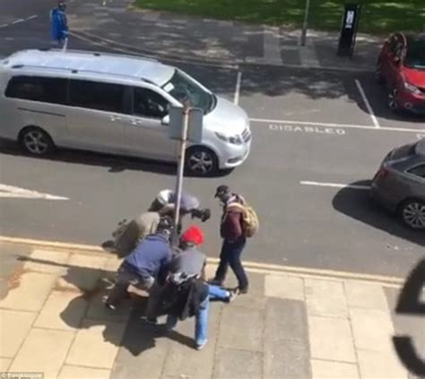 undercover police light package cops tackle man approaching bus with suspicious package