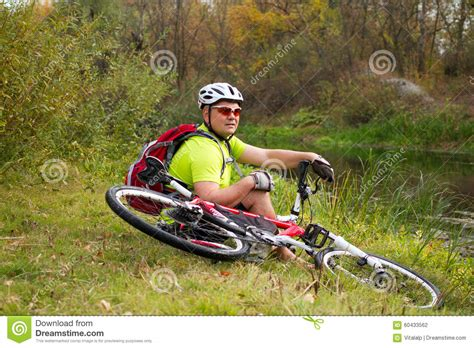 Kaos Rocky Bike Graphic 1 Oceanseven athlete crossing rocky terrain with bicycle in his stock photo image 60433562