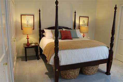 4 poster bed four poster bed with red blue and white accents traditional bedroom los angeles by
