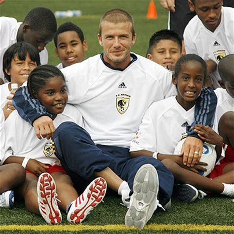 David Beckham Charity Biography   luxury photos and articles stylelist