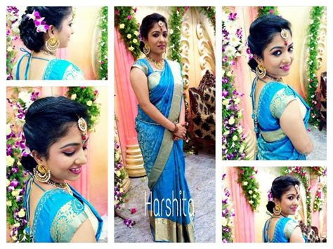 Traditional Southern Indian bride wearing bridal hair, saree and jewellery. Reception look