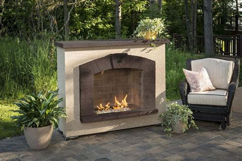 Outdoor Stone Arch Gas Fireplace with Stucco Finish