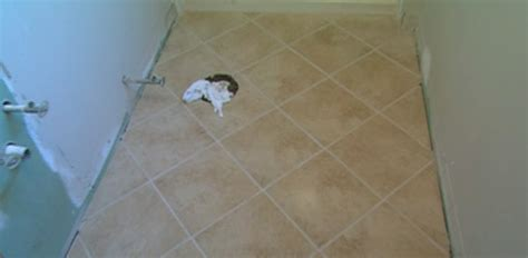 how to tile a bathroom floor how to tile a bathroom floor today s homeowner