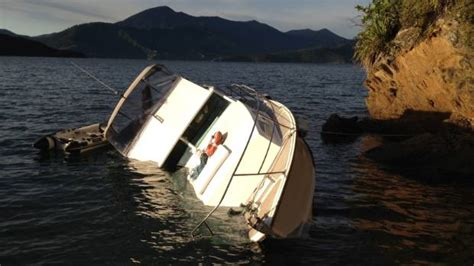 sinking boat sound man and cat rescued from sinking boat in marlborough after