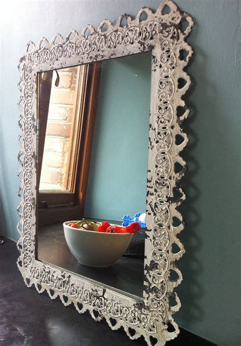 ornate framed mirror by the forest co