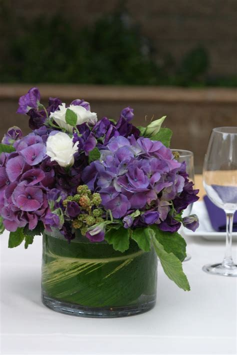 1000 ideas about purple flower centerpieces on