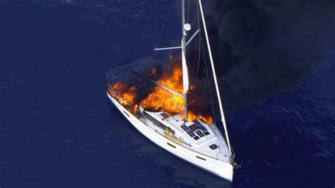 fire boat captain captain rescued after sailboat catches fire off southern
