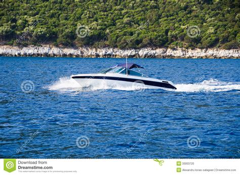 speed boat on water speed boat on blue water stock photo image 33003720