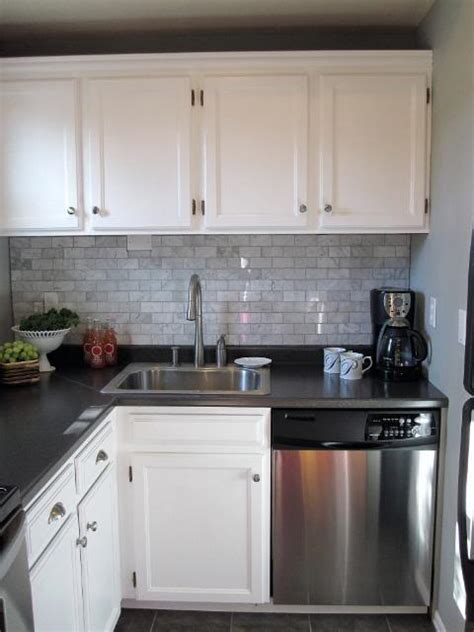 Black Laminate Kitchen Cabinets Carrara Marble Subway Tile Transitional Kitchen Sherwin Williams Sensible Hue Freckles