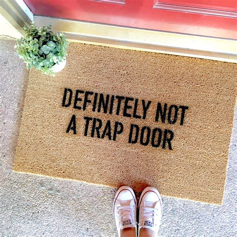 funny door mat the quot this is not a trap door quot doormat funny doormats