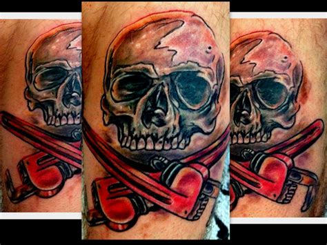 plumbing tattoos plumber skull and cross bone by plumber