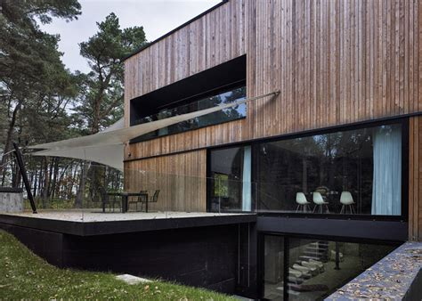 textured front facade modern box home polish house with wood textured concrete interior