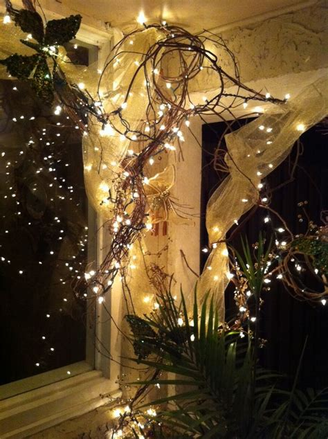 grapevine wrapped  white lights  toolfront porch