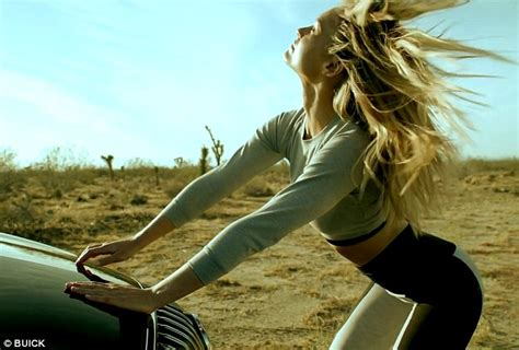 gurl beach buick commercial bar refaeli strikes poses with buick in caign for gm s