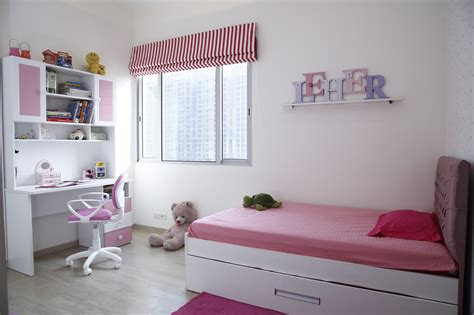 small cushioned bed  pink  white themed study table