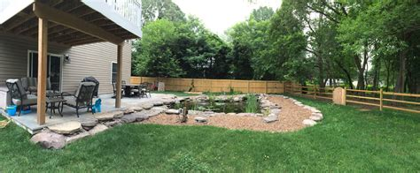 put grass in backyard a backyard idea set in severn md premier ponds dc md va pond contractor