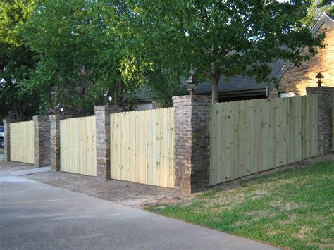 brick and wood fence living outside pinterest wood