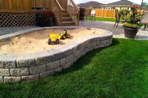 Backyard Sandbox Ideas Brick Retaining Wall Sandbox Backyard Escape Pinterest The Plastics Sandbox And Flower