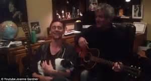 tom hiddleston cuddles  dog   serenades fans daily mail