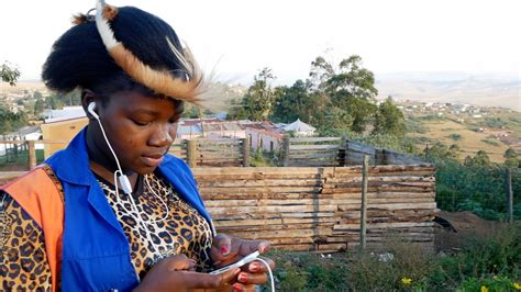 south african house music free download african stock video of a black traditional woman listening to music on a smartphone