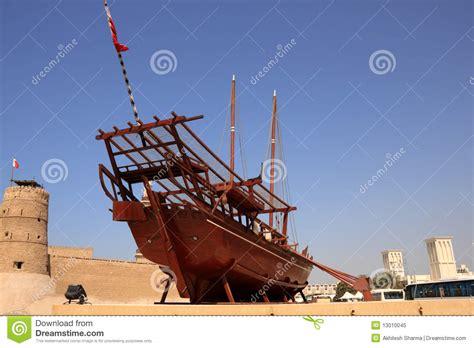 outside displays boat on display outside dubai museum stock image