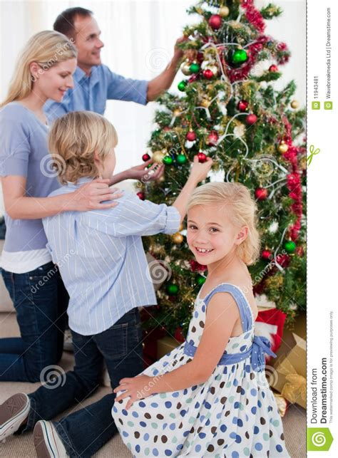family christmas tree jarrettsville family hanging decorations on a tree stock image image 11943481
