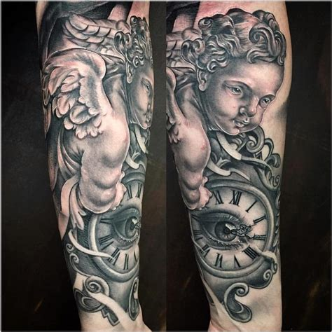mystics tattoo realistic cherub with clock in black and gray by