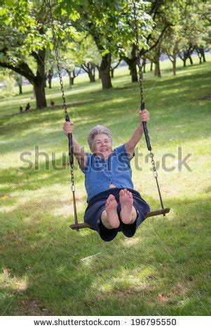woman swinging baby around video baby father sitting on swing stock photo 231264205