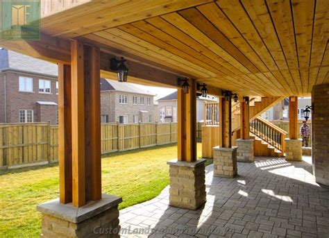 Walkout Basement Designs cedar deck with walkout basement and pergola traditional