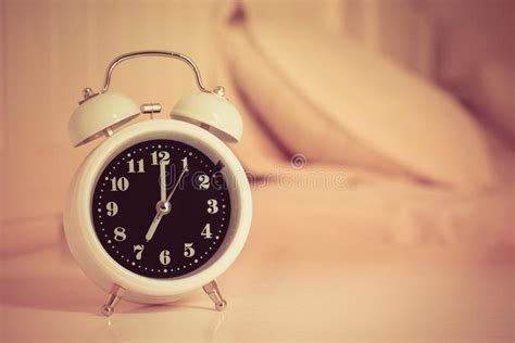 alarm clock bed alarm clock on the bed in bedroom retro style stock photo
