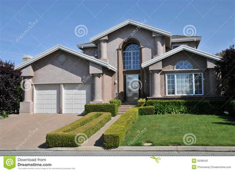 house plans with 2 separate garages two car garage house with decorative schrubs stock photo image 9338540