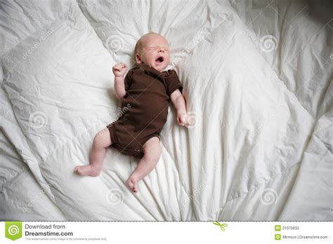 baby sleeping in bed new born baby sleeping in his bed stock photos image