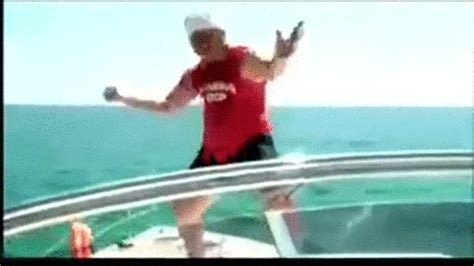 falling out of boat funny drunk guy jumps off a boat on make a gif