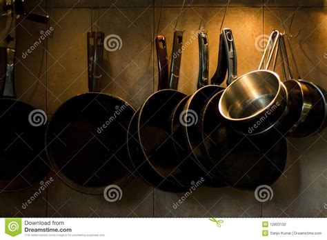 Hanging Pans On Wall Pans Hanging On Kitchen Wall Stock Photo Image 12803132