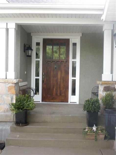 front door     grey house  white trim