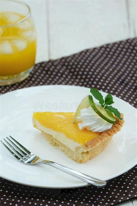 lemon tart dessert with orange juice drink refreshment stock photo image 56646754