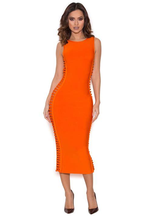 Dresss Orange khloe shows curvaceous figure in a clinging
