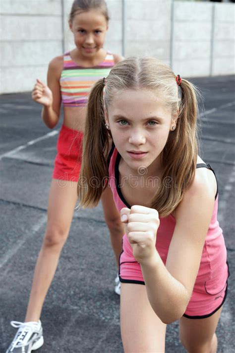 preteen model stock photos and images preteen girls running stock photo image of green