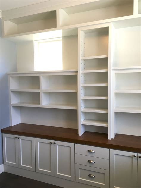 wall to wall builtin shelves young son woodworks
