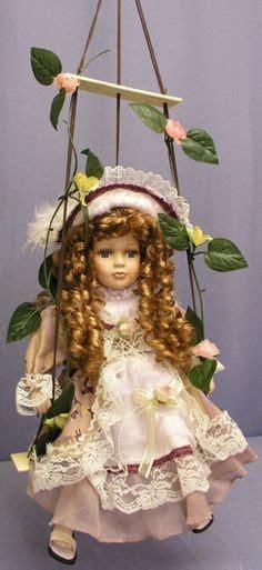 porcelain doll on swing dolls on dolls porcelain and
