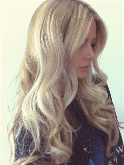 rolling up your hair in curls in preparation for an updo you curl the hair with any size curling iron a 1 5 was
