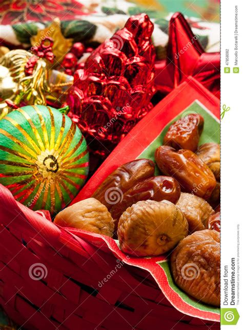 dried figs and dates with christmas decorations stock