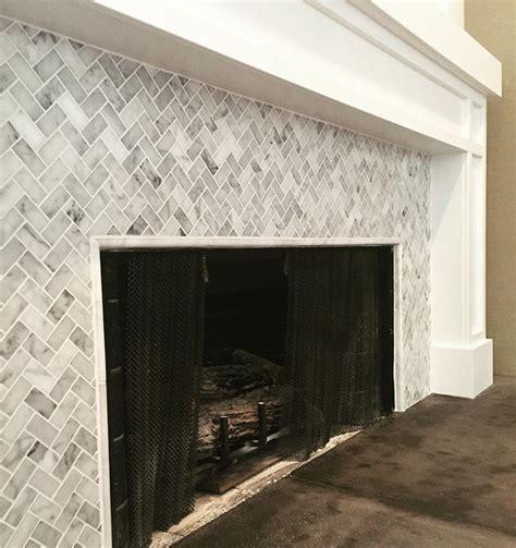 white carrera herringbone fireplace face marbletile carrera oc remodel herringbone