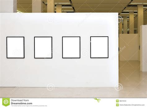 exhibition with four empty frames on white walls stock images image 8841944
