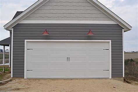 garage door lights a carriage garage door and barn lights newlywoodwards